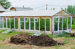 Greenhouse and heap of manure Stock Image