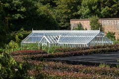 Greenhouse horticulture. English country garden farming as a cot Royalty Free Stock Photo