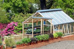 Greenhouse or hothouse set in a well maintained garden.  royalty free stock photos