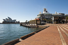 Opera house and cruise ship Sydeny. The building in the centre of the shot is a temporary structure built using recyeled materials or materials that can be Stock Image