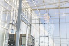 Low angle view of farmer seen through window at distribution storehouse stock photo