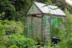 Plastic Bottle Greenhouse. Greenhouse made of old plastic bottles stock photos