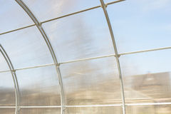 Greenhouse made of polycarbonate and metal carcass. Small hothouse. Metal construction covered with transparent polycarbonate Stock Image