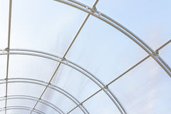 Greenhouse made of polycarbonate and metal carcass. Small hothouse. Metal construction covered with transparent polycarbonate Royalty Free Stock Images