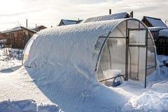 Greenhouse polycarbonate unit tunes snow. Russia, Siberia, Novosibirsk region Stock Images