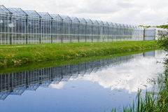 Greenhouse reflected in canal Royalty Free Stock Photos
