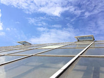 Greenhouse roof with open windows for ventilation against blue s Royalty Free Stock Photography