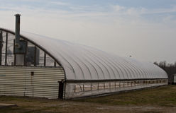 Greenhouse with side open. A hydroponic greenhouse full of tobacco seedlings with the side open for circulation.  Mid March in western Kentucky can bring Royalty Free Stock Images