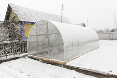 Greenhouse and snow Royalty Free Stock Photo