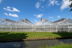 Greenhouse in Westland, the Netherlands. Commercial glass greenhouses in Westland. Westland is a region in of the Netherlands. It lies in the western part of the Stock Photo