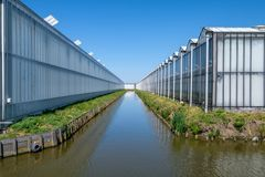 Greenhouses as far as you can see, Westland, the Netherlands. Commercial glass greenhouses in Westland. Westland is a region in of the Netherlands. It lies in Stock Image