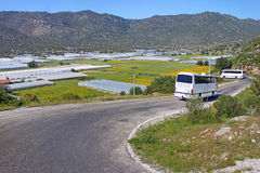 Greenhouses and buses near village in Turkey stock photo