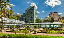 Greenhouses in the city botanical garden. Royalty Free Stock Photo