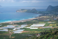 Greenhouses in Crete. Tens of greenhouses, mediterranean sea on the background stock photography