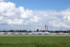 Greenhouses on field Royalty Free Stock Images