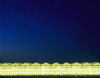 Greenhouses at night Stock Photos