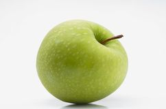 Greening. Ripe green apple on a white background Royalty Free Stock Image