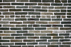 Greenish black and gery Brick Wall Stock Image