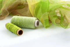 Greenish silk and matching threads Stock Images