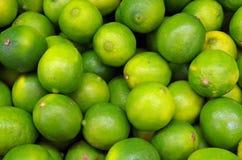 Greenish yellow limes closeup Stock Photography