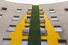 Green yellow building. Greenish yellow residential building with a profound perspective Royalty Free Stock Photo