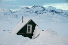 Greenland. A green house in a snow-covered landscape, Greenland royalty free stock image