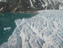 Greenland coast. Coastal rocks and ice glacier at Greenland Stock Photography