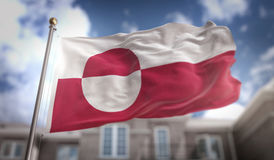 Greenland Flag 3D Rendering on Blue Sky Building Background Stock Photos