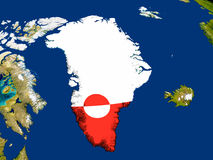 Greenland with flag on Earth Stock Images