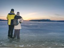 Greenland hiking travel tourist lovers with hold hands stock photos
