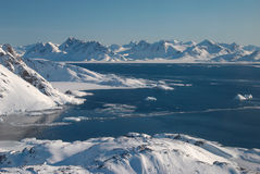 Greenland, ice floe and mountains. Landscape of ice floe and mountains, Greenland royalty free stock photography