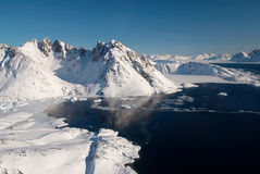 Greenland, ice floe and mountains. Landscape of ice floe and mountains, Greenland stock photo