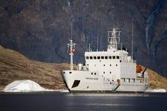 Greenland - Icebreaker in Scoresbysund. The Russian Icebreaker MV Grigoriy Mikheev in Northwest Fjord in Scoresbysund in eastern Greenland Royalty Free Stock Photo
