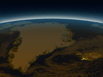 Greenland and Iceland from space in the evening. Greenland and Iceland in the evening from Earth's orbit in space. 3D illustration with detailed planet surface Stock Photos