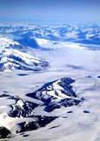 Greenland landscape. Aerial view of snowy Greenland landscape with mountains in background stock photography
