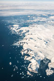 Greenland Mountain coastline  under the plane wings Royalty Free Stock Photography
