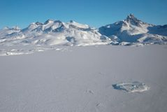 Greenland, mountains and ice floe. Ice floe with mountains in background, Greenland stock photos