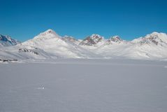 Greenland, mountains and ice floe. Ice floe with mountains in background, Greenland royalty free stock image