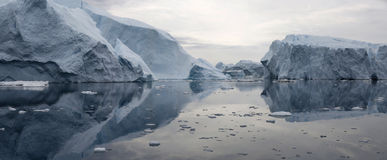 Greenland. Nature and landscapes of Greenland. Travel on the scientific vessel among ices. Studying of a phenomenon of global warming. Ices and icebergs of royalty free stock photos