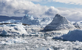 Greenland. Nature and landscapes of Greenland. Travel on the scientific vessel among ices. Studying of a phenomenon of global warming. Ices and icebergs of royalty free stock image
