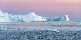 Greenland. Nature and landscapes of Greenland. Travel on the scientific vessel among ices. Studying of a phenomenon of global warming. Ices and icebergs of Royalty Free Stock Photography