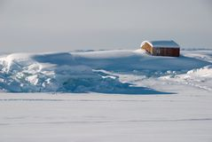 Greenland's house. A wooden house in a snow-covered landscape, Greenland royalty free stock photo