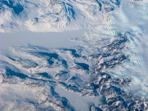 Greenland snow river and waves. Aerial view of the Greenland with mountain, snow river and waves royalty free stock photos