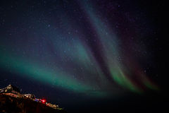Greenlandic Northern lights over Nuuk city Stock Photo