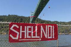 Greenpeace Activists Dangling Over St Johns Bridge with Sign Royalty Free Stock Photos