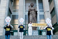 Greenpeace flash mob. Sicily - April 11: Greenpeace activists make an flash mob in front of the courthouse, they are protest against the main energy supplier in Stock Image