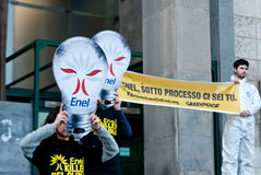 Greenpeace flash mob light bulbs. Sicily - April 11: Greenpeace activists make an flash mob in front of the courthouse, they are protest against the main energy Royalty Free Stock Images