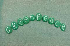 Greenpeace, non-governmental environmental organization text withgreen stones royalty free stock photography