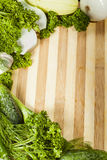 Greens on a chopping board Stock Image