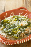 Greens with farinheira and rice Stock Photography